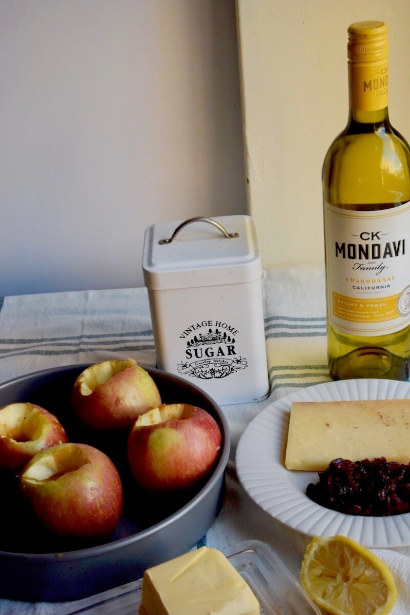 AD Baked Apples with Cheddar Cheese, Sugar. Cranberries and CK Mondavi Chardonnay. A very easy dessert to make in autumn or the Christmas Season. #CKMondaviWines #CKMondaviAmbassador #CKMondaviHolidayBaking#ChristmasDessert #apples #bakedapples